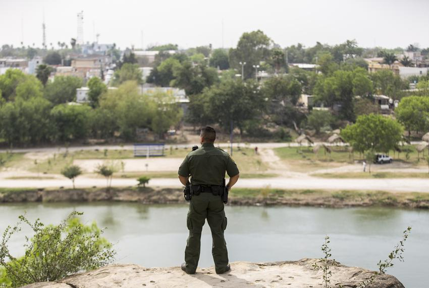 From Roma, Texas, Border Patrol Agent Isaac Villegas looks out over the Rio Grande and into Ciudad Miguel Alemán, Mexico, ...