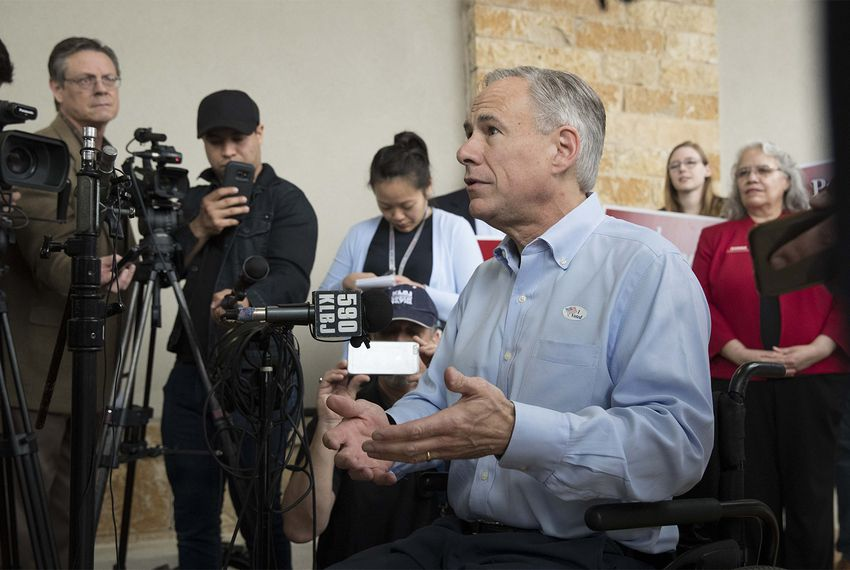 Gov. Greg Abbott talks to the press after casting his vote in Austin on Tuesday, Feb. 20, 2018, the first day of early voting in Texas for the March primary elections.