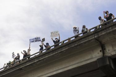 Protesters marched onto Interstate 35 during a rally at the Austin Police Headquarters in downtown Austin.