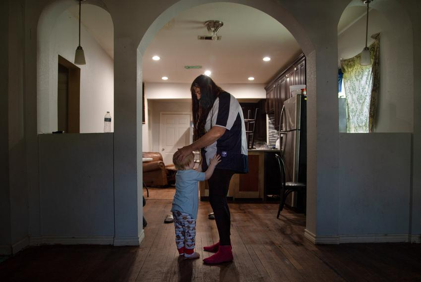 Kenny Proctor gives his grandmother, Lucille Hammash, a quick hug in the front room of their house in central Houston on Apr…