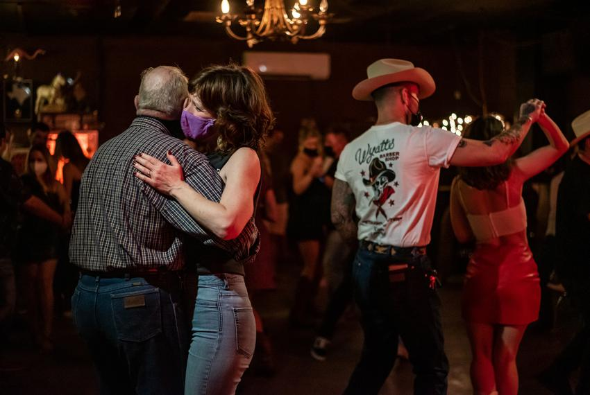 People dance inside White Horse in East Austin on March 12, 2021. After Gov. Greg Abbott announced that all businesses are a…
