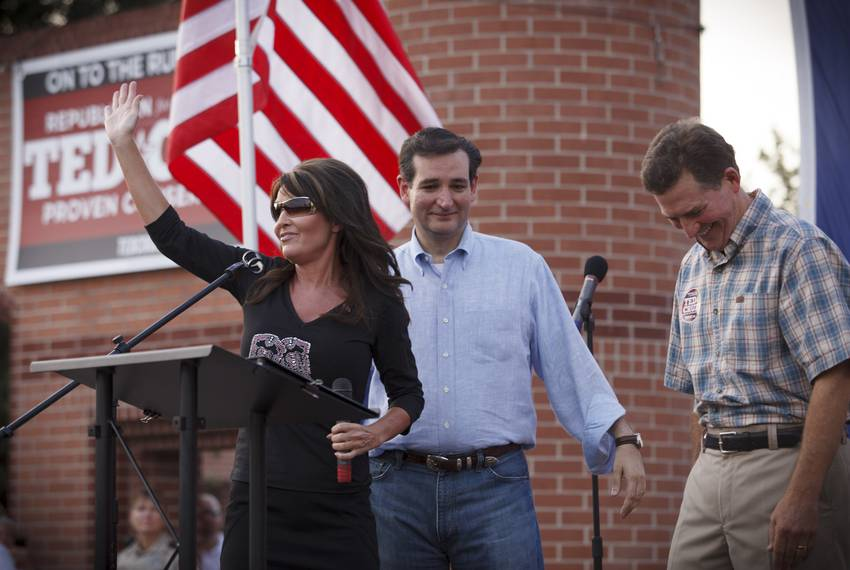 Republican primary candidate Ted Cruz, center, is joined on stage by Sarah Palin, left, and Senator Jim DeMint, right, at a rally in The Woodlands, Texas, o...