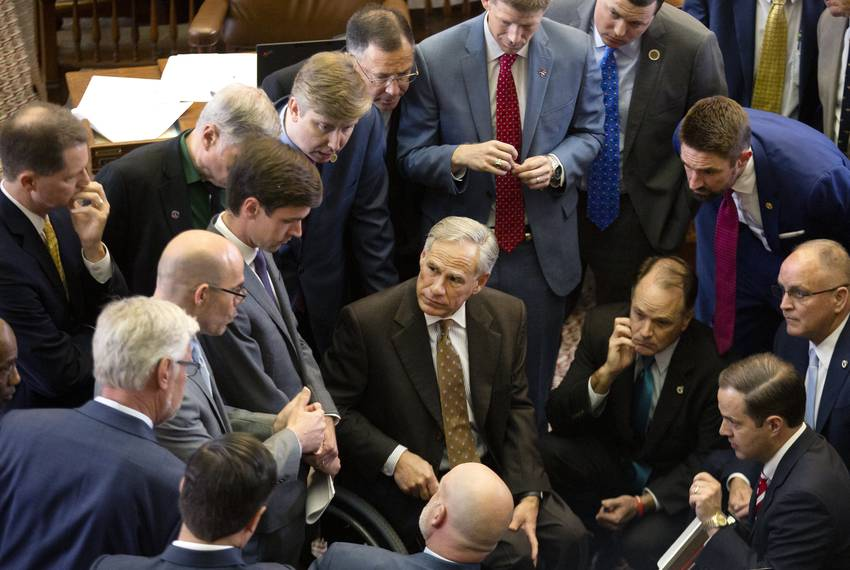 Gov. Greg Abbott with House members on the House Floor on April 30, 2019.