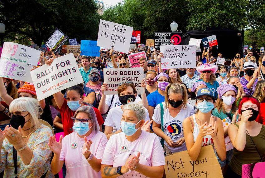 People hold signs and clap during the Womenís March ATX at the Texas Capitol in Austin, Texas, on Saturday, Oct. 2, 2021. Th…