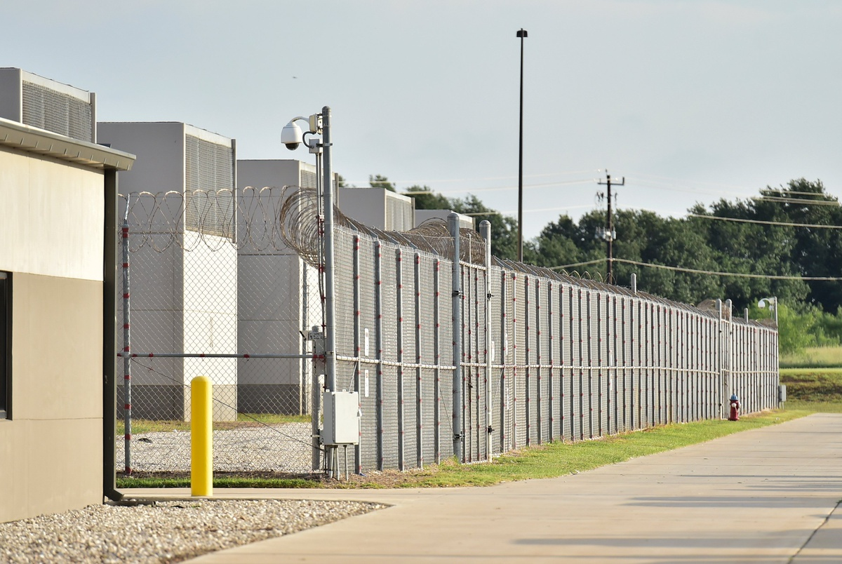 COVID-19 cases at a Texas immigration detention center soared. Now, town leaders want answers.