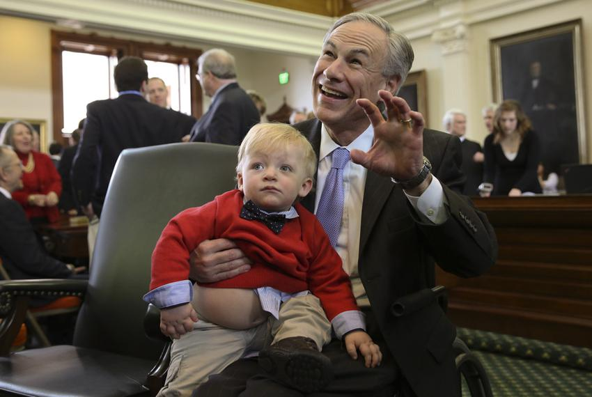 Governor-elect Greg Abbott poses with the grandson of state Sen. John Whitmire, D-Houston, on Jan. 13, 2015.