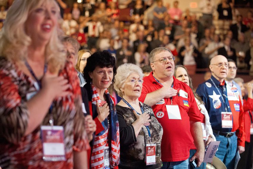 Texas Republican Convention attendees stand for the Pledge of Allegiance in Fort Worth in 2012.