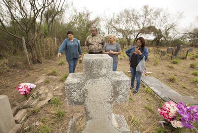 (left to right) Gina Wisdon, Juan Mancias tribal chair of the Carrizo/Comecrudo group, Adelina Yarrito and Cecilia Gonzales at the Eli Jackson Cemetery in San Juan, Texas on February 11, 2019