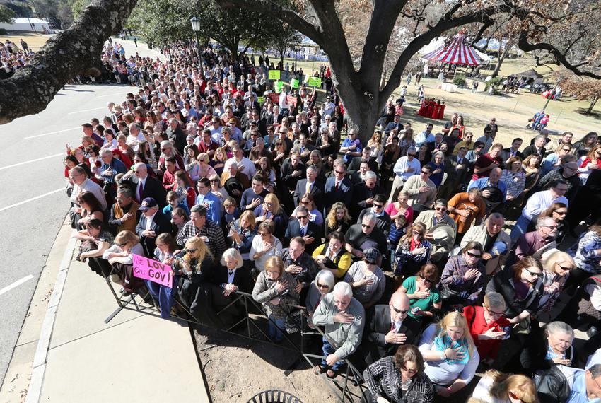 A crowd is shown during the Pledge of Allegiance at the inauguration ceremony for Gov. Greg Abbott and Lt. Gov. Dan Patrick.
