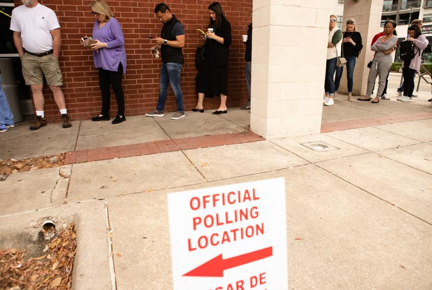 People stand in line to vote at Oak Lawn Branch Public Library in Dallas Nov. 6, 2018.