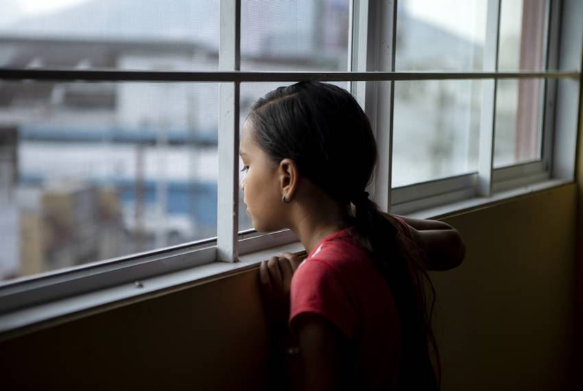 Elibette Trujillo looks out of a window at Casa Indi in Monterrey, Nuevo Leon on Aug. 6, 2019. Elibette migrated from Honduras with her mother Nora Valdez. ...