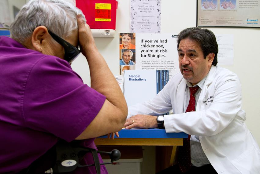 Dr. Javier Saenz with a patient, Elena Chavez, 73. Chavez is part of the 50 percent of patients Saenz sees who draw from b...