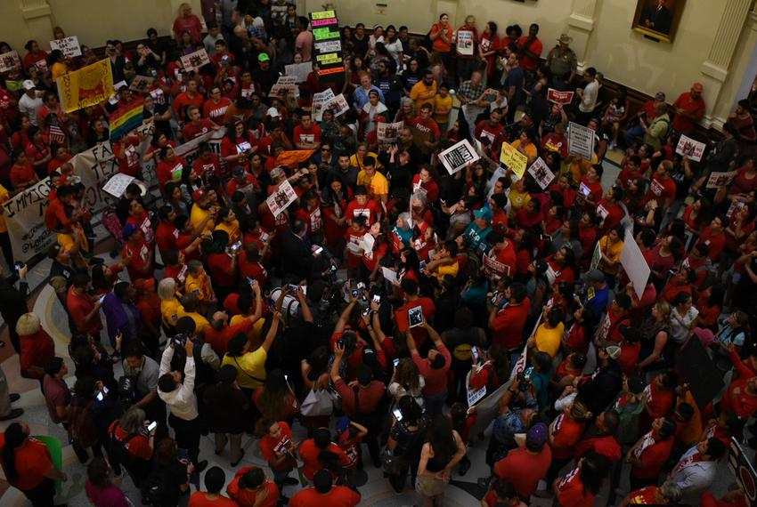 "The floor of the state Capitol is packed with protesters opposed to Senate Bill 4, the ""sanctuary cities"" bill, on May 29,..."