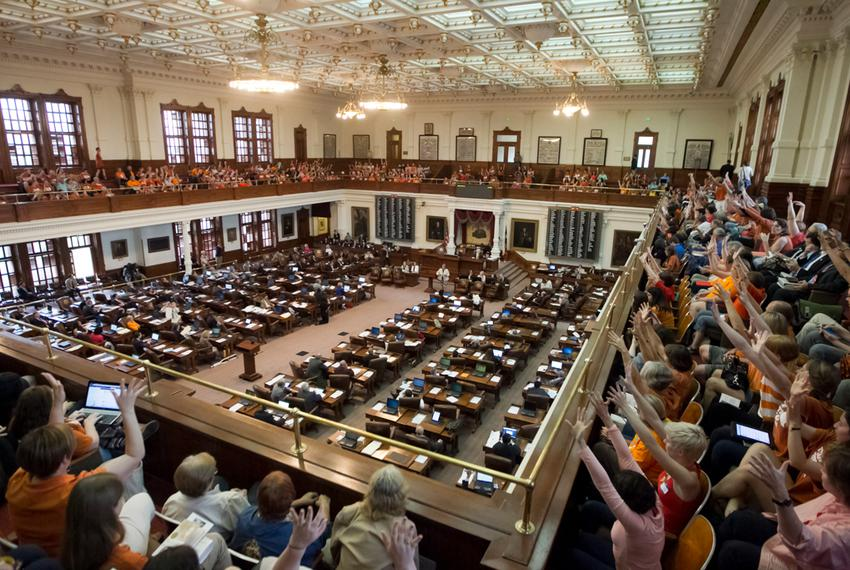 "A packed Texas House gallery, filled mostly with the pro-choice group ""Stand with Texas Women,"" cheer during a speech by Rep…"