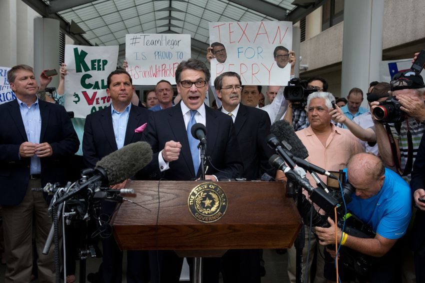 Texas Gov. Rick Perry speaks to supporters after he is booked into the Blackwell-Thurman Justice Center in Austin following his indictment on two felony counts related to defunding District Attorney Rosemary Lehmberg's Public Integrity Unit.