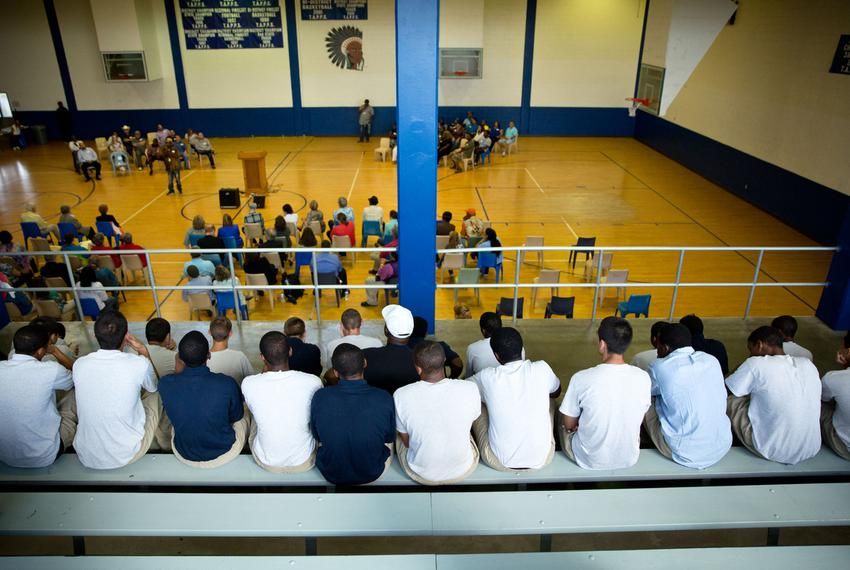 Current incarcerated youths watch the HYPE program from the elevated bleachers in the Giddings State School gym.