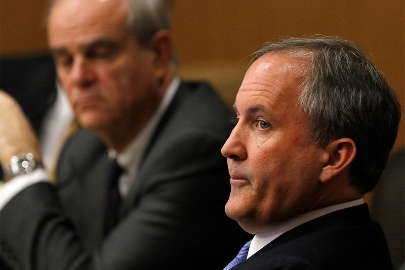 Texas Attorney General Ken Paxton, right, looks at one of the special prosecutors during a pre-trial hearing at the Collin County Courthouse on Dec. 1, 2015. Paxton faces felony charges related to claims that he misled investors in business dealings before he took office as attorney general.