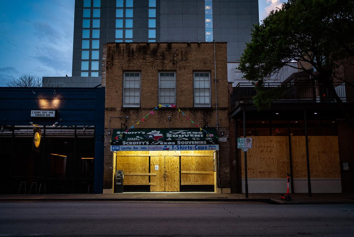 Shuttered businesses on  Sixth Street in Austin during the COVID-19 pandemic on March 19, 2020.