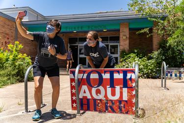 Two voters take a selfie after voting in Texas' July primary runoffs at Zilker Elementary School on July 14, 2020.