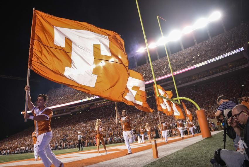 """Members of the Texas Cheer & Pom fly flags spelling """"TEXAS"""" after Texas scoring at a game against Louisiana State on Sept. 7…"""