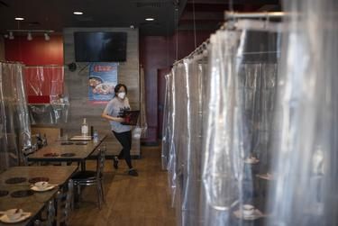 Houston, Texas: Debbie Chen walks through the Shabu House restaurant on June 16, 2020 in Houston, Texas. Mark Felix/The Texas Tribune