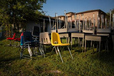 Surplus desks and chairs are provided to help students create effective learning spaces in their homes at the Drive-Thru Student School Supply Giveaway at Raul Yzaguirre Schools for Success in Houston on Aug. 22, 2020.