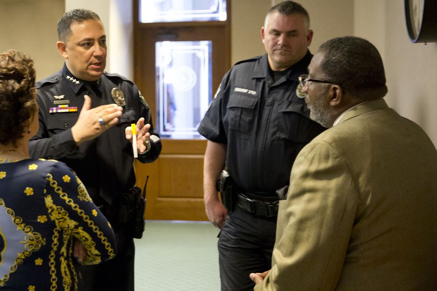 Austin Police Chief Art Acevedo and Austin Police Association President Kenneth Casaday speak with state Sen. Royce West, D-Dallas, right, on Feb. 12, 2015, at the Texas Capitol.