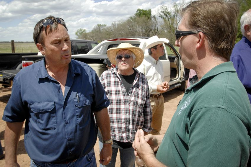 Paul McGuire, with the federal Bureau of Land Management, speaks with landowners in Clay County on April 28, 2014.