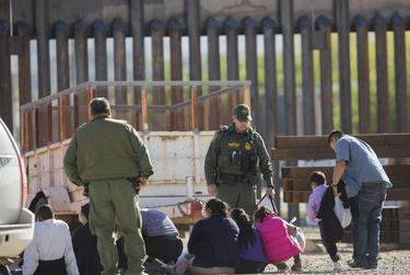 A migrant group is detained near the Paso del Norte International Bridge in El Paso.