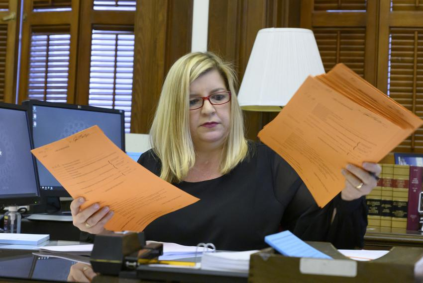 Tracy Snowden Ortiz works to sort bills filed with the Secretary of the Senate for the 86th session of the Texas Legislature…