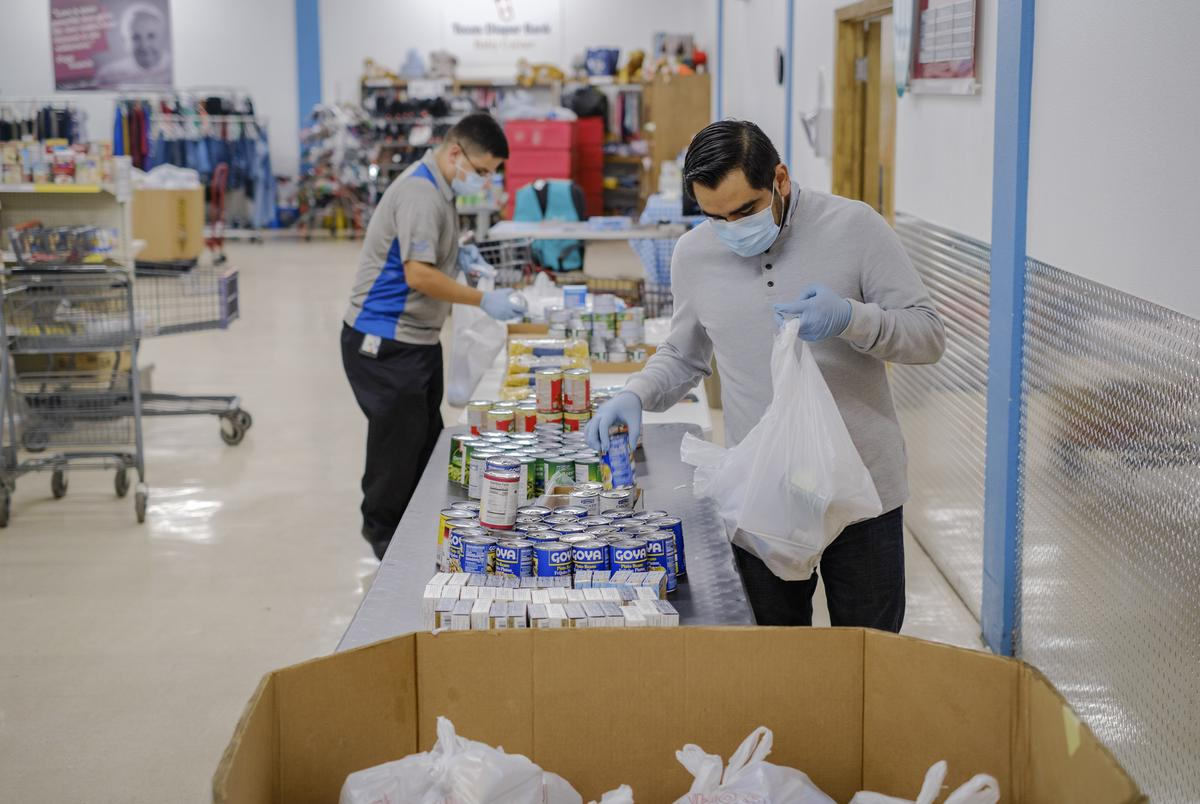 Staff members at the St. Andrews food pantry run by the Catholic Charities in San Antonio on Feb. 25, 2021.