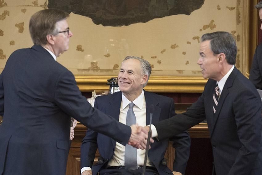 Gov. Greg Abbott looks on as Lt. Gov. Dan Patrick (left) and House Speaker Joe Straus shake hands at the Capitol on May 27, …