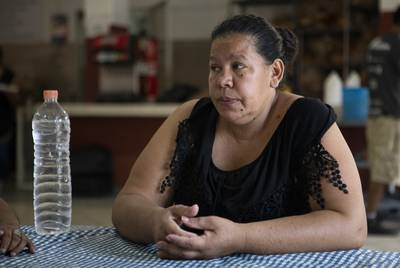 Anjelica Zavala sits at a table in the dining room at Casa INDI. According to Zavala, her parents, husband and cousins were murdered by gangs in El Salvador. Zavala has an asylum hearing scheduled for the fall. Aug. 6, 2019.