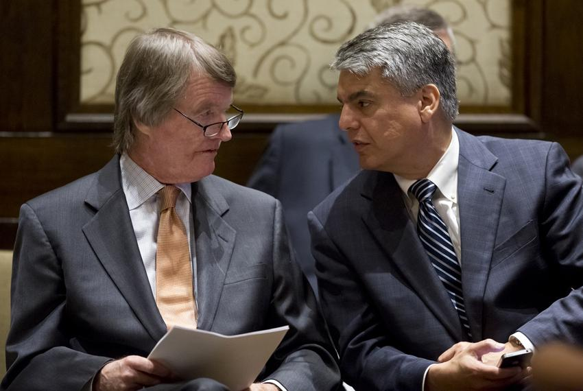 University of Texas President Bill Powers speaks to Provost Gregory Fenves during a board of regents meeting on July 10, 2...