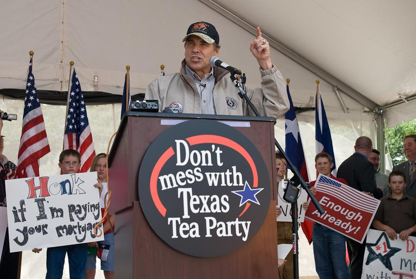 "Texas Gov. Rick Perry addresses a crowd estimated at 1,000 at a tax day ""tea party"" April 15 at City Hall to protest federal…"