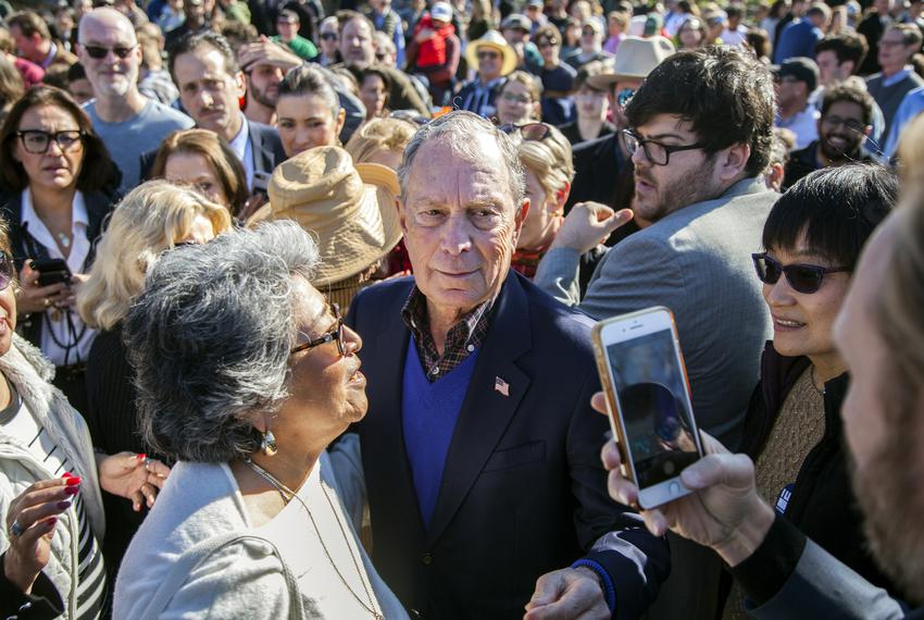 Democratic presidential candidate Michael Bloomberg walks through a crowd of supporters at a rally at Central Machine Works …