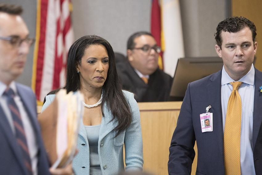 State Rep. Dawnna Dukes, D-Austin, turns to leave the 450th District Court of Judge Brad Urrutia with attorney Matt Shrum,...