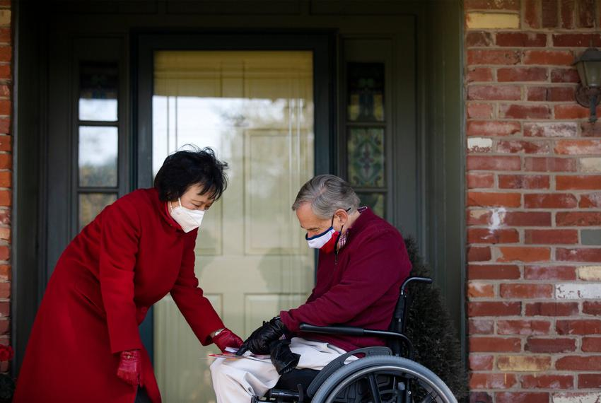 Gov. Greg Abbott joins state Rep. Angie Chen Button, R-Richardson, for a block walk on Oct. 24 in Richardson.
