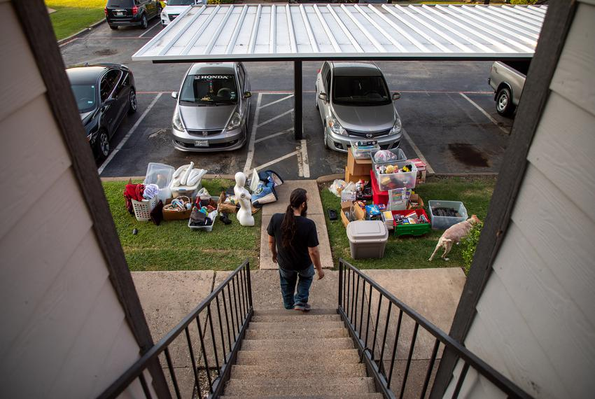 Jared Brown looks over his family's belongings on the morning of their eviction from their Plano apartment.