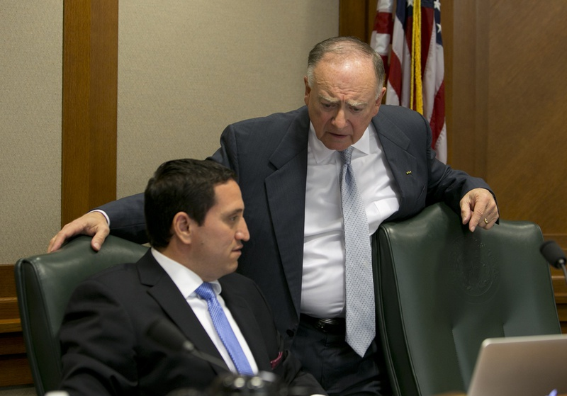 State Rep. Dan Flynn (right), R-Van, talks to state Rep. Trey Martinez Fischer, D-San Antonio, on Oct. 23, 2013. Van is co-chair of the House Select Committee on Transparency in State Agency Operations, whose members include Fischer.