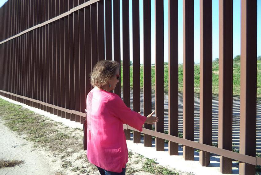 Eloisa Tamez stands near the border fence built on land formerly owned by her family.