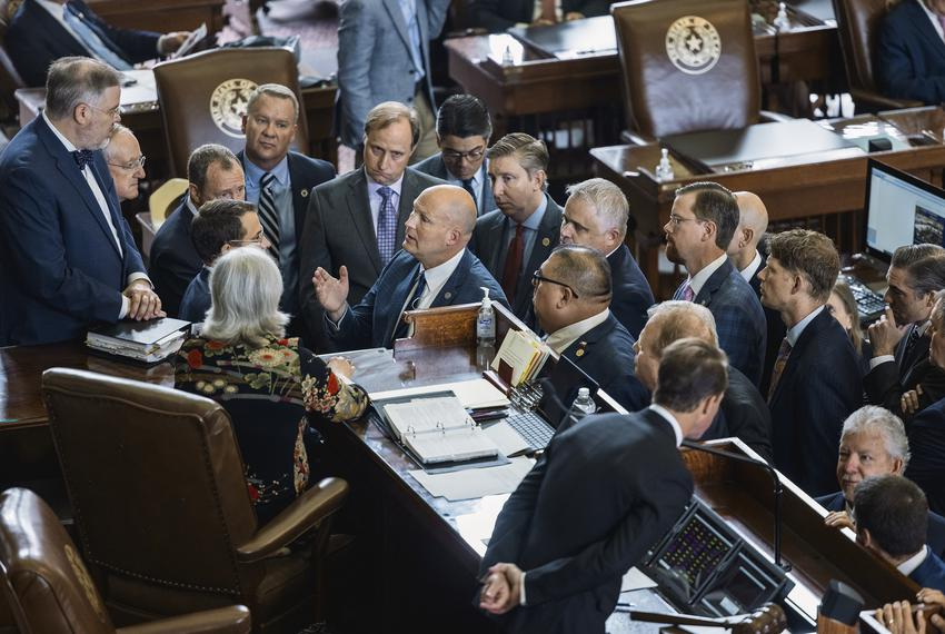 House Republicans crowd around the speakers desk to discuss a point of order attempting to strip absent members of their com…