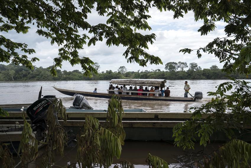 Migrants cross the Usumacinta River between La Técnica, Guatemala and Frontera Corozal, Mexico on Oct. 21. The Usumacinta ...