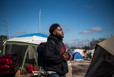LaShawn Ramsey resides at the state-sanctioned homeless campsite in Austin.