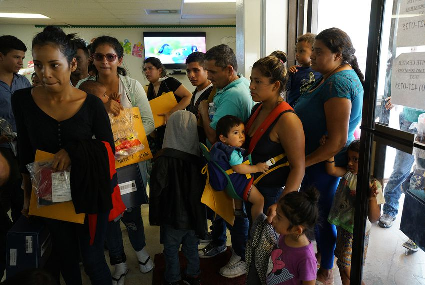 Immigrant families enter the Catholic Charity in McAllen on June 29, 2018.