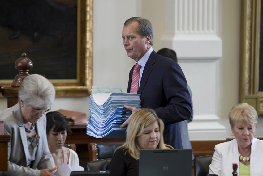Lt. Gov. David Dewhurst delivers a stack of bills to the secretary of the Senate on May 27, 2013.
