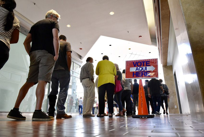 Voters lined up at the Austin Community College Highland Campus in Austin for the first day of early voting on Oct. 24, 2016.