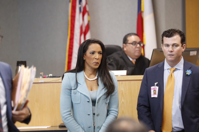 State Rep. Dawnna Dukes, D-Austin, appeared in the Travis County Courthouse on June 30, 2017. In the yellow tie is attorney Matt Shrum.