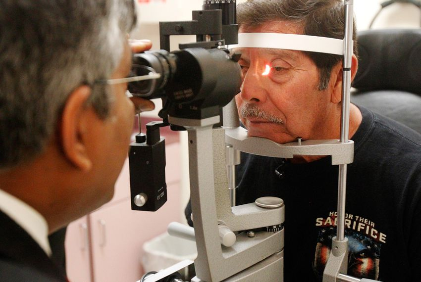 Dr. Alexander P. Sudarshan, an ophthalmologist, examined Jose Juan Herrera, a Vietnam War veteran, last month in Weslaco. Dr. Sudarshan treats patients referred by Veterans Affairs.
