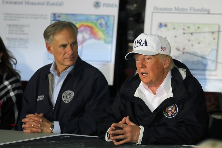 President Donald Trump receives a briefing on Tropical Storm Harvey relief efforts with Gov. Greg Abbott in Corpus Christi o…